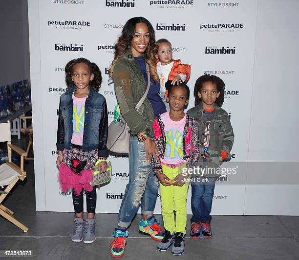 Alexis Stoudemire poses with her kids Alijah Ar'e Assata and Amar'e Jr during the CCandy Clothing show at the Petite Parade Kids Fashion Show at 545...