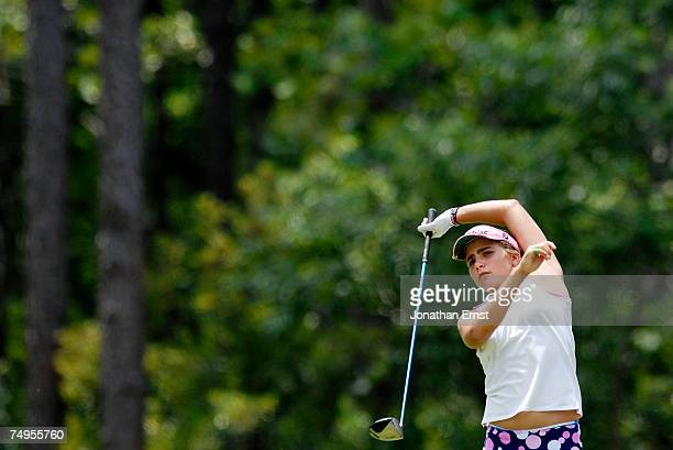 Alexis Thompson finishes her tee shot from the 6th tee onehanded during round two of the US Women's Open Championship at Pine Needles Lodge Golf Club...