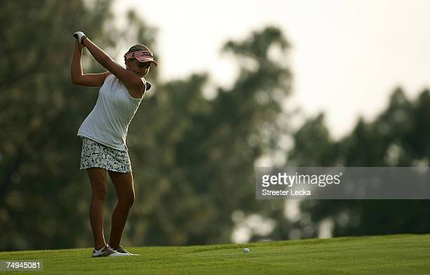 Alexis Thompson hits her approach shot on the 12th hole during round one of the US Women's Open Championship at Pine Needles Lodge Golf Club on June...