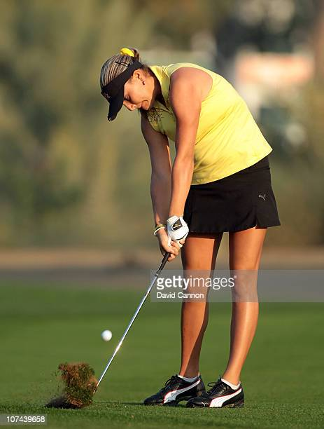Alexis Thompson of the USA plays her third shot at the 10th hole during the second round of the 2010 Omega Dubai Ladies Masters on the Majilis Course...