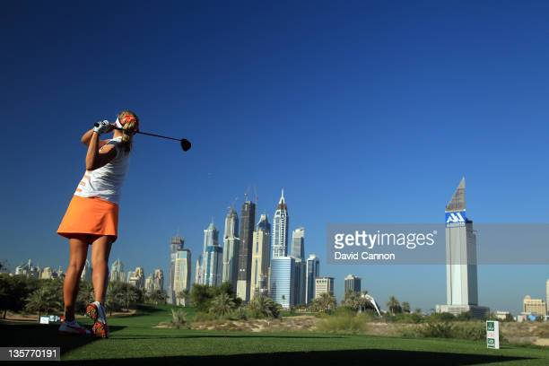 Alexis Thompson of the USA tees off at the par 4, 8th hole during the first round of the 2011 Omega Dubai Ladies Masters on the Majilis Course at the...