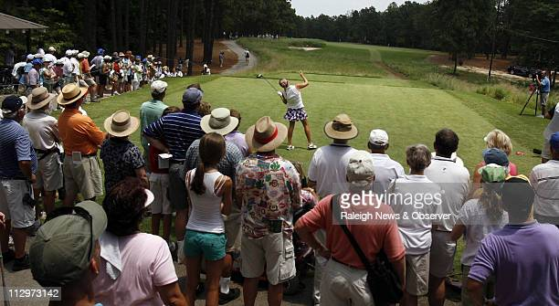Alexis Thompson uses body language to steer a drive onto the ninth hole fairway during the second round of the US Women's Open at Pine Needles in...