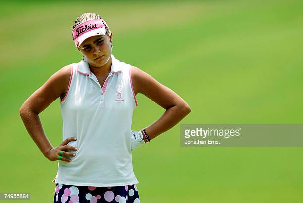 Alexis Thompson waits for a playing partner to finish putting on the 6th green during round two of the US Women's Open Championship at Pine Needles...