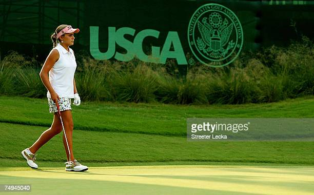 Alexis Thompson walks across the 12th green during round one of the US Women's Open Championship at Pine Needles Lodge Golf Club on June 28 2007 in...