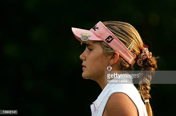 Alexis Thompson walks off the 13th tee during round one of the US Women's Open Championship at Pine Needles Lodge Golf Club on June 28 2007 in...