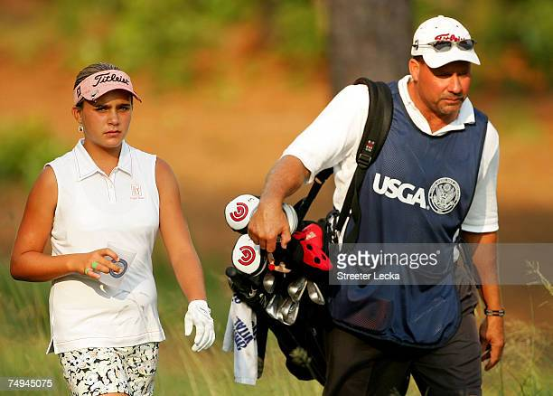 Alexis Thompson walks with her father/caddie Scott during round one of the US Women's Open Championship at Pine Needles Lodge Golf Club on June 28...