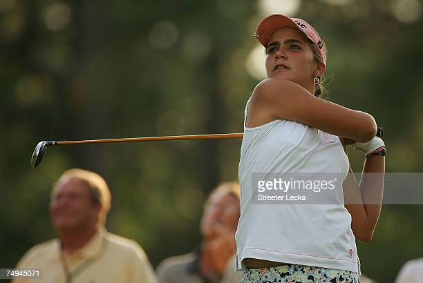 Alexis Thompson watches her tee shot on the 13th hole during round one of the US Women's Open Championship at Pine Needles Lodge Golf Club on June 28...