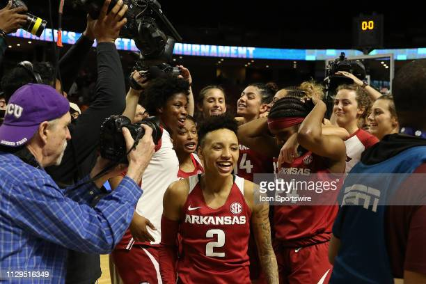 Alexis Tolefree guard of Arkansas is all smiles after defeating Texas AM during the SEC Women's basketball tournament between the Arkansas Razorbacks...