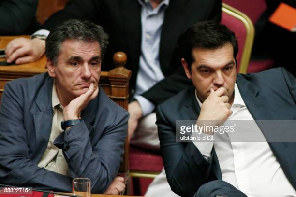 Alexis Tsipras and Finance minister Euclid Tsakalotos during the vote on the draft law with the prior actions of the agreement with Greece's...