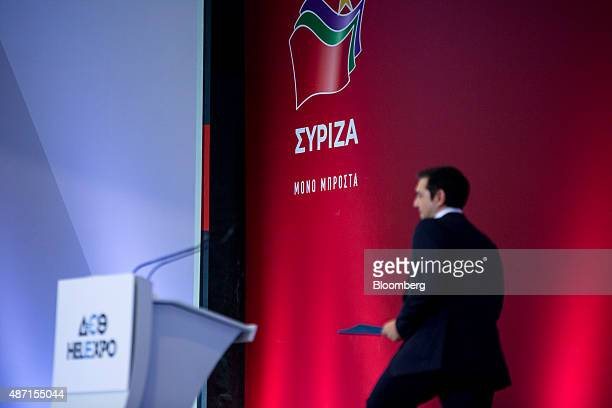 Alexis Tsipras former Greek prime minister and leader of the Syriza party walks to the podium at the Thessaloniki International Trade Fair in...