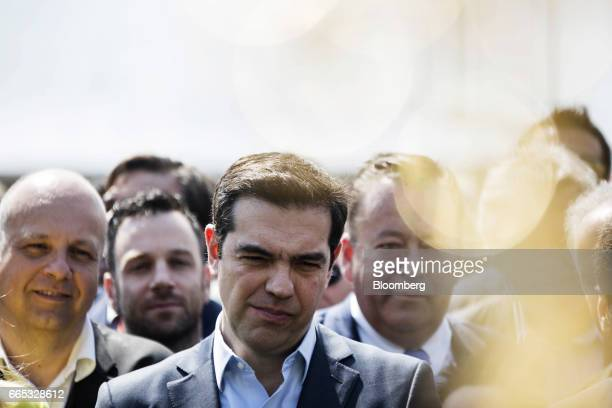 Alexis Tsipras Greece's prime minister center attends the opening ceremony of the Tempe road tunnels in Thessaly Greece on Thursday April 6 2017...