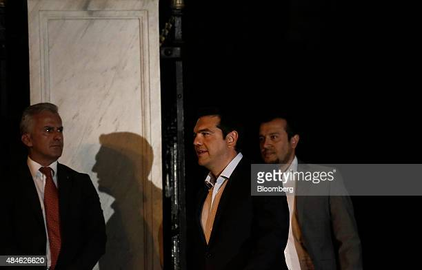 Alexis Tsipras Greece's prime minister center exits the presidential palace after meeting with Greek President Prokopis Pavlopoulos not pictured in...
