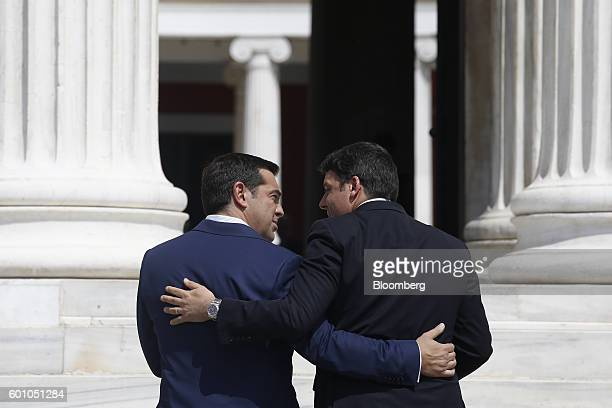 Alexis Tsipras Greece's prime minister left embraces Matteo Renzi Italy's primer minister as he arrives for the first Mediterranean European Union...