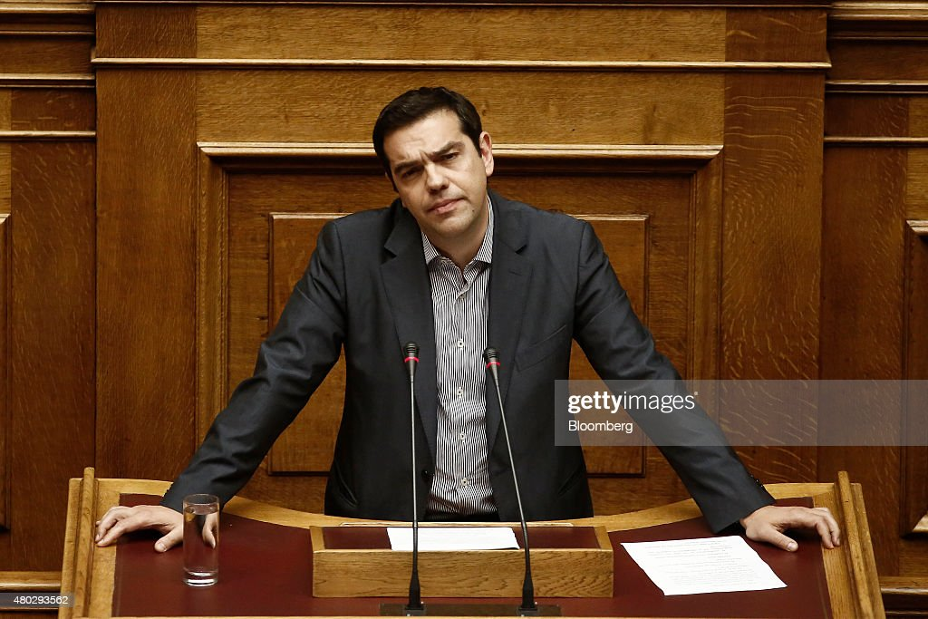Alexis Tsipras, Greece's prime minister, pauses as he presents his package of bailout measures, inside the Greek parliament in Athens, Greece, on Saturday, July 11, 2015. Greek lawmakers debated Prime Minister Alexis Tsiprasâs bailout proposal into the early hours of Saturday before a weekend of political wrangling with creditors on his nationâs place in the euro. Photographer: Kostas Tsironis/Bloomberg via Getty Images