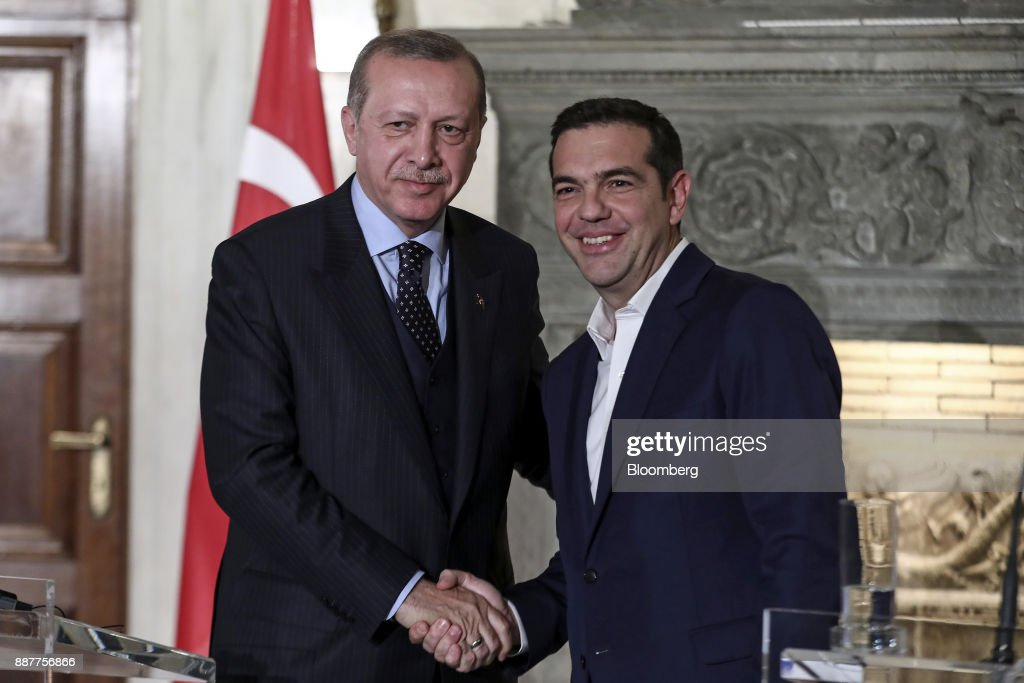 Alexis Tsipras, Greece's prime minister, right, and Recep Tayyip Erdogan, Turkey's president, pose for photographs during a news conference at Maximos Mansion in Athens, Greece, on Thursday, Dec. 7, 2017. Erdogan starts a two-day visit to Greece that includes a meeting with Tsipras. Photographer: Yorgos Karahalis/Bloomberg via Getty Images