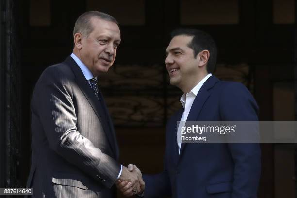 Alexis Tsipras Greece's prime minister right shakes hands with Recep Tayyip Erdogan Turkey's president as he arrives for a meeting at Maximos Mansion...