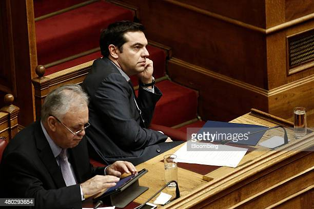Alexis Tsipras Greece's prime minister right sits and listens at the Greek parliament in Athens Greece on Saturday July 11 2015 Greek lawmakers...