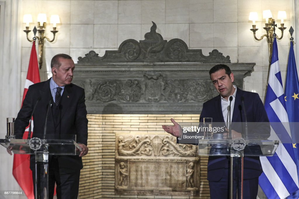 Alexis Tsipras, Greece's prime minister, right, speaks as Recep Tayyip Erdogan, Turkey's president, listens during a news conference at Maximos Mansion in Athens, Greece, on Thursday, Dec. 7, 2017. Erdogan starts a two-day visit to Greece that includes a meeting with Tsipras. Photographer: Yorgos Karahalis/Bloomberg via Getty Images