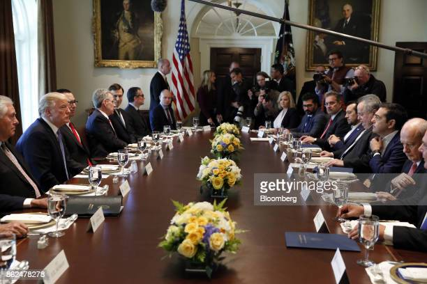 Alexis Tsipras Greece's prime minister second right speaks as US President Donald Trump second left listens during a working lunch in the Cabinet...