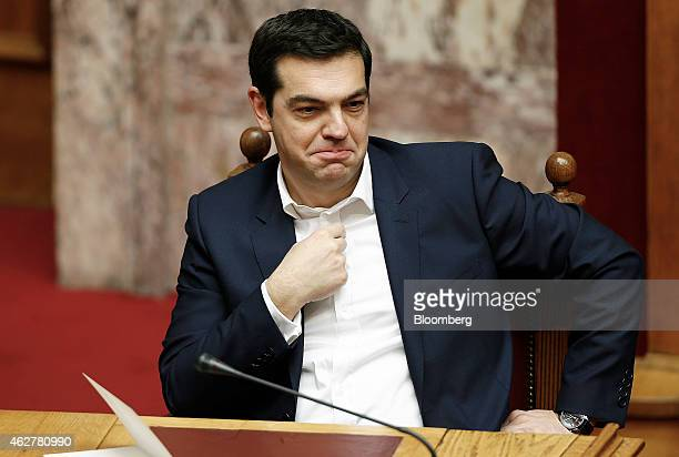 Alexis Tsipras Greece's prime minister sits and waits ahead of the swearingin ceremony for the new government held at the Greek Parliament building...