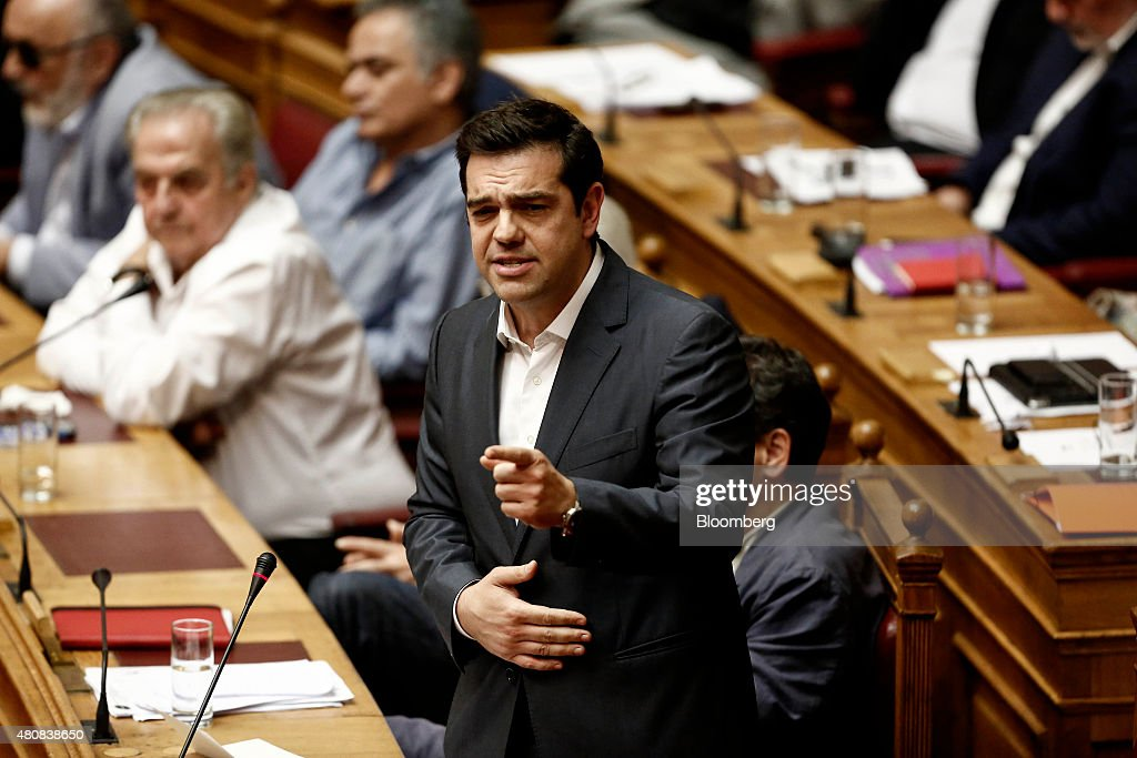 Alexis Tsipras, Greece's prime minister, speaks before a parliamentary vote on whether to accept bailout conditions in Athens, Greece, on Thursday, July 16, 2015. Greek lawmakers passed a bailout agreement that keeps the country in the euro for now, shifting attention to the European Central Bank as it weighs whether to pump more money into the country's hobbled financial system. Photographer: Kostas Tsironis/Bloomberg via Getty Images