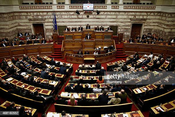 Alexis Tsipras Greece's prime minister speaks to lawmakers in Athens Greece on Monday March 30 2015 'The Greek government's strategy of isolating...