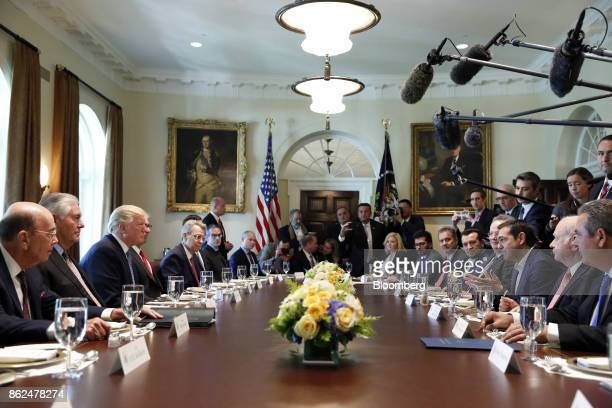 Alexis Tsipras Greece's prime minister third right speaks as US President Donald Trump third left listens during a working lunch in the Cabinet Room...