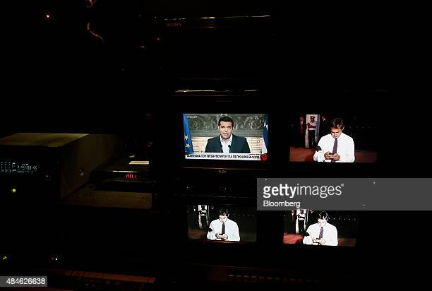 Alexis Tsipras Greece's prime minister top left is seen on a television monitor addressing the nation in Athens Greece on Thursday Aug 20 2015...
