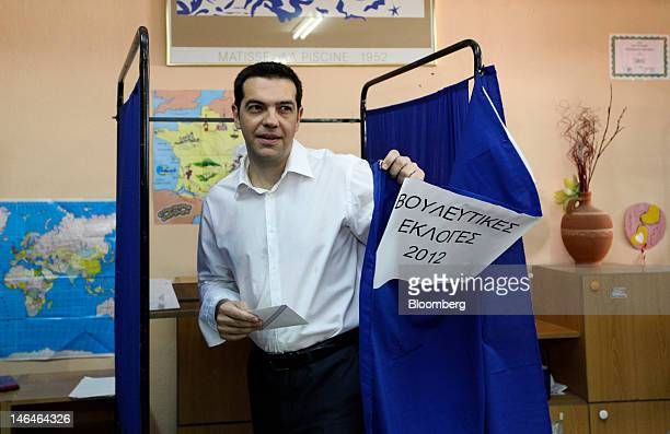 Alexis Tsipras leader of Greece's Syriza party leaves a voting booth after marking his ballot paper in the second round of the Greek general...