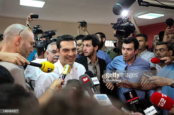 Alexis Tsipras leader of Greece's Syriza party speaks to the media after casting his vote in the second round of the Greek general elections at a...