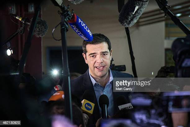 Alexis Tsipras leader of the radical Syriza speaks to waiting media after he cast his vote at a polling station in a school in a suburb of Athens on...