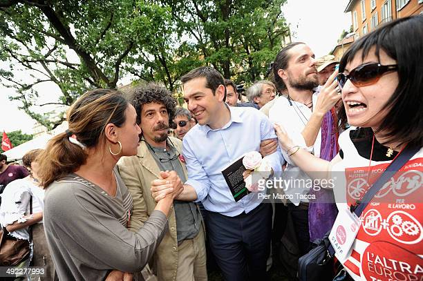 Alexis Tsipras the European Left Party's candidate for President of the European Commission shakes hands during a press conference at Universita...