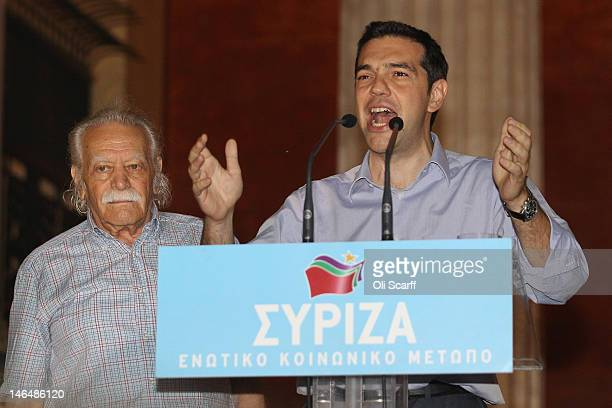 Alexis Tsipras the leader of the Syriza party stands next to Greek resistance hero Manolis Glezos as he addresses the crowd at a rally outside the...