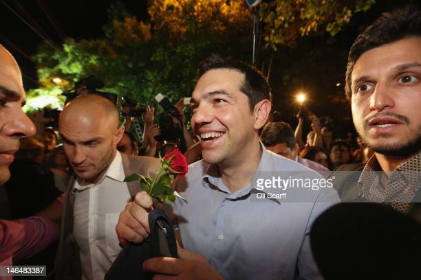 Alexis Tzipras the leader of the Syriza party is congratulated by supporters as he arrives at his party's offices following a projected second place...