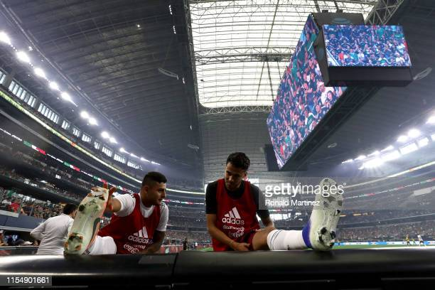 Alexis Vega and Diego Reyes of Mexico warm up during a international friendly against Ecuador at ATT Stadium on June 09 2019 in Arlington Texas
