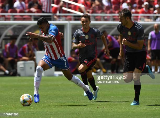 Alexis Vega of Chivas de Guadalajara controls the ball against Benfica their 2019 International Champions Cup match at the Levi's Stadium in Santa...