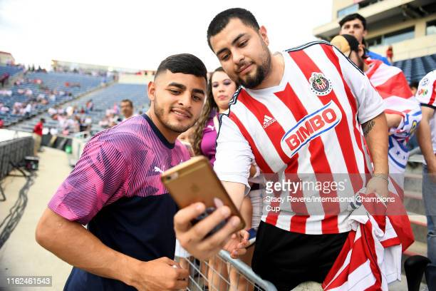 Alexis Vega of Chivas de Guadalajara signs autographs for fans before the match against ACF Fiorentina during the 2019 International Champions Cup at...