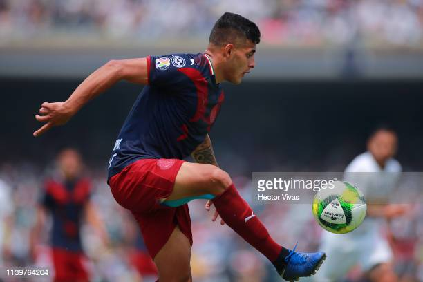 Alexis Vega of Chivas drives the ball during the 12th round match between Pumas UNAM and Chivas as part of the Torneo Clausura 2019 Liga MX at...