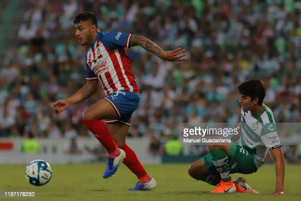 Alexis Vega of Chivas drives the ball during the 1st round match between Santos Laguna and Chivas as part of the Torneo Apertura 2019 Liga MX at...