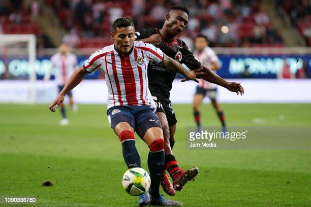 Alexis Vega of Chivas fights for the ball with Fabián Castillo of Tijuana during the first round match between Chivas and Tijuana as part of the...