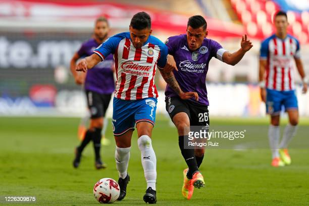 Alexis Vega of Chivas fights for the ball with Paul Rocha of Mazatlan during the match between Chivas and Mazataln FC as part of the friendly...