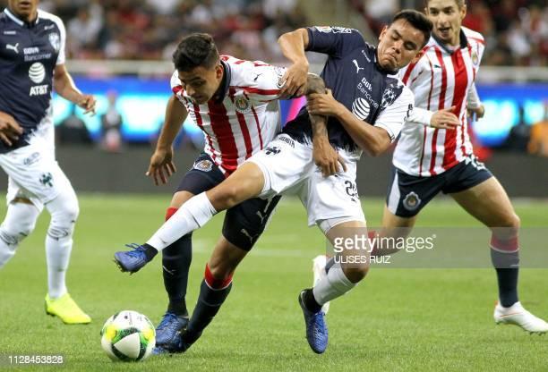 Alexis Vega of Guadalajara vies for the ball with Carlos Rodriguez of Monterrey during their Mexican Clausura 2019 tournament football match at Akron...