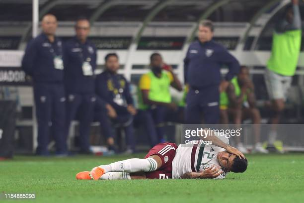 Alexis Vega of Mexico is injured during a match between Ecuador and Mexico at ATT Stadium on June 9 2019 in Arlington Texas