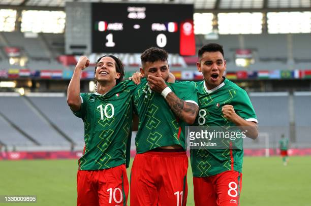 Alexis Vega of Team Mexico celebrates with teammates Carlos Rodriguez and Diego Lainez after scoring their side's first goal during the Men's First...