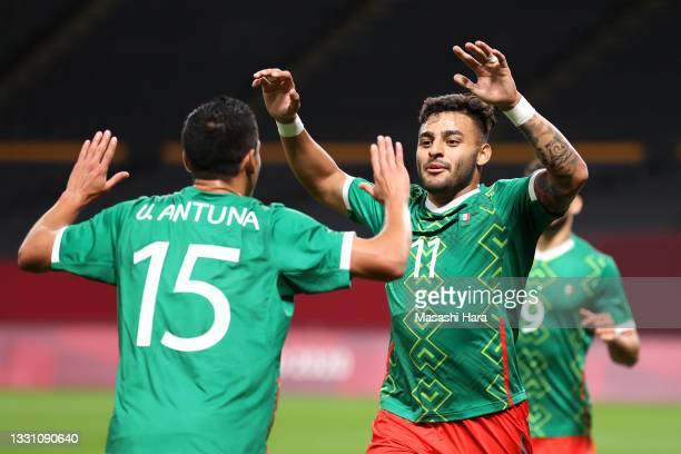 Alexis Vega of Team Mexico celebrates with Uriel Antuna after scoring their side's first goal during the Men's First Round Group A match between...