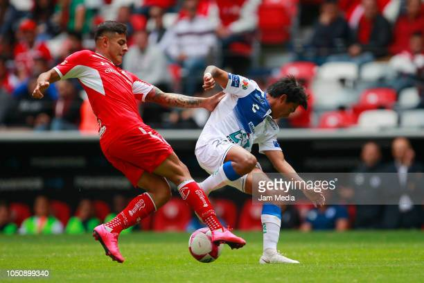 Alexis Vega of Toluca and Pablo Lopez of Pachuca fight for the ball during the 12th round match between Toluca and Pachuca as part of the Torneo...