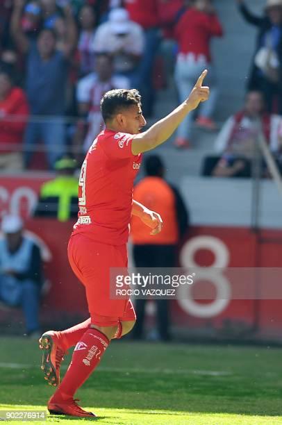 Alexis Vega of Toluca celebrates after scoring against Guadalajara during their Mexican Clausura football tournament match at the Nemesio Diez...