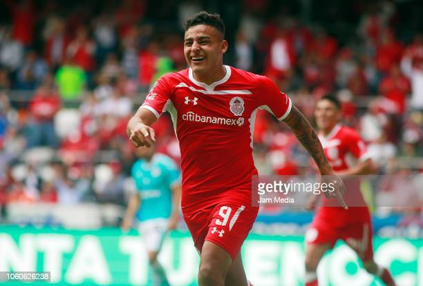 Alexis Vega of Toluca celebrates after scoring the first goal of his team during a 14th round match between during the 14th round match between...