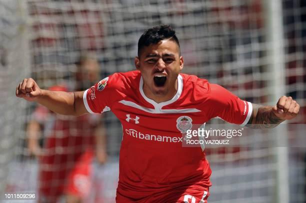 Alexis Vega of Toluca celebrates his goal against Guadalajara during the Mexican Apertura 2018 tournament football match at the Nemesio Diez stadium...