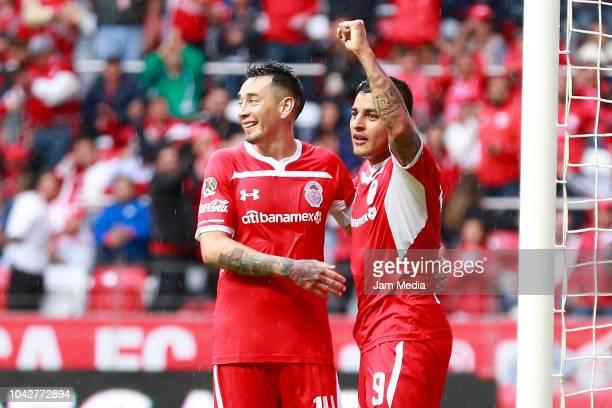 Alexis Vega of Toluca celebrates with teammate Rubens Sambueza after scoring the third goal of Toluca during the 10th round match between Toluca and...